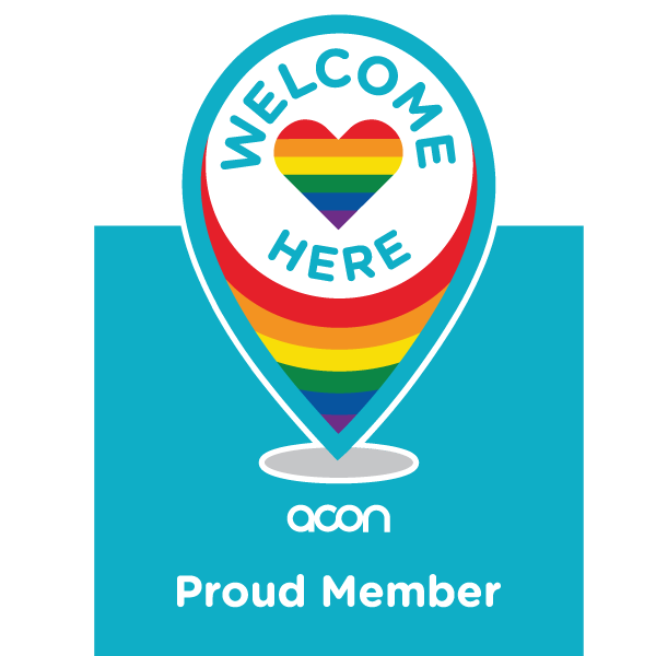 Welcome Here proud member logo - a location pin image with love heart and LGBTQI+ rainbow